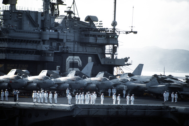 Sailors stand in formation in front of EA-6B Prowler aircraft aboard the aircraft carrier USS RANGER (CV-61) as the vessel enters port on its last visit to Japan. The RANGER is on its final deployment piror to decommissioning
