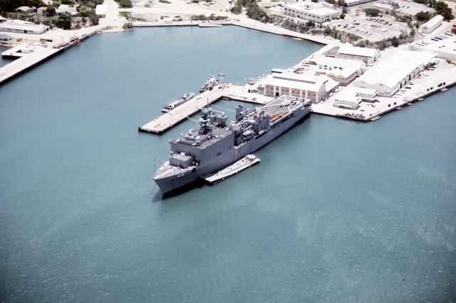 An overhead, port bow view of the dock landing ship USS ASHLAND (LSD-48) Med-moored in port. The ASHLAND is taking on supplies destined for Florida communities devastated by Hurricane Andrew as part of Operation Help From the Sea