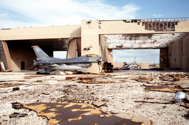A pair of F-16 Fighting Falcons which were left in the alert complex lay destroyed after the hangar they were stored in was destroyed by Hurricane Andrew
