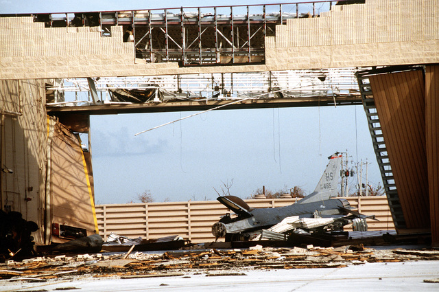 An F-16 Fighting Falcon left in the alert complex lay destroyed after the hangar in which it was stored was destroyed by Hurricane Andrew