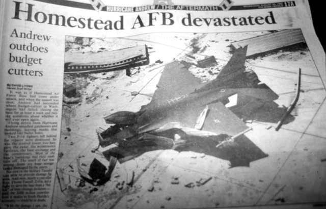 A close-up view of the front page of a Miami newspaper displaying an article about the base damage sustained during Hurricane Andrew, which struck the area on August 24th
