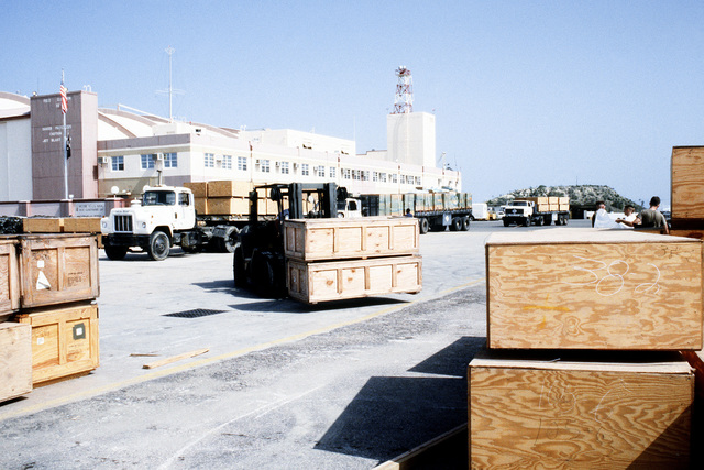 A forklift is used to move crates of supplies destined for Flordia communities devastated by Hurricane Andrew as part of Operation Help From the Sea