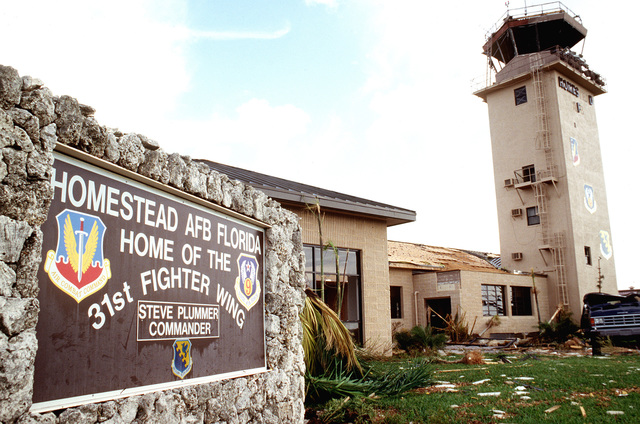Damaged control tower and welcome sign. Hurricane Andrew drove through the air base damaging every building on the base