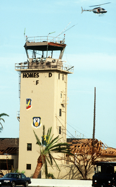 The base control tower and surrounding buildings exhibit damage sustained during Hurricane Andrew, which struck the area on August 24th
