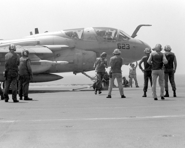 Flight deck crewmen prepare a Tactical Electronic Warfare Squadron 136 (VAQ-136) EA-6B Prowler aircraft for launch on the flight deck of the aircraft carrier USS INDEPENDENCE (CV-62). The INDEPENDENCE is participating in Operation Southern Watch, a multinational effort establishing a no-fly zone for Iraqi aircraft south of the 32nd parallel in Iraq