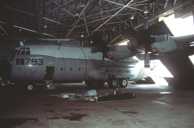 Hangers that housed ground equipment and a C-130 received heavy damage during Hurricane Omar. These hangers belong to VRC-50, a U.S. Navy squadron based at Anderson AFB, Guam