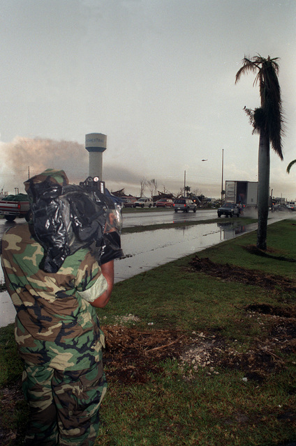 A cameraman videotapes disaster relief efforts in the aftermath of Hurricane Andrew