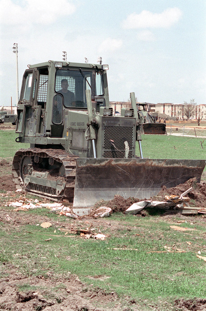 A Case 450 dozer is used by Marines to clear debris during disaster relief efforts in the aftermath of Hurricane Andrew