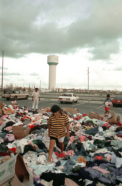 Area residents sort through mounds of clothing delivered by volunteers as part of disaster relief efforts in the aftermath of Hurricane Andrew
