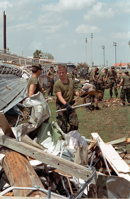 Military personnel clean up debris as they take part in disaster relief efforts in the aftermath of Hurricane Andrew