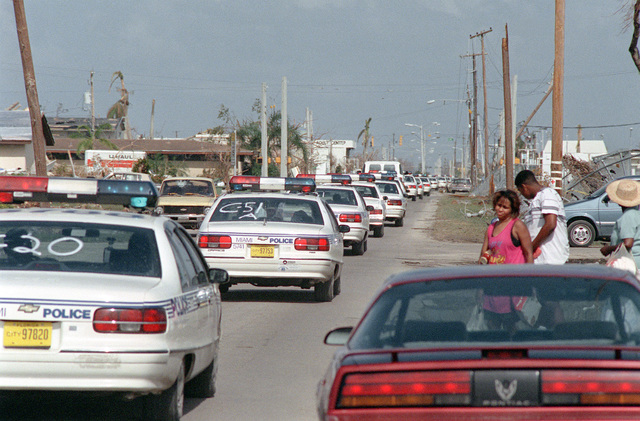Police arrive to provide security during disaster relief efforts in the aftermath of Hurricane Andrew