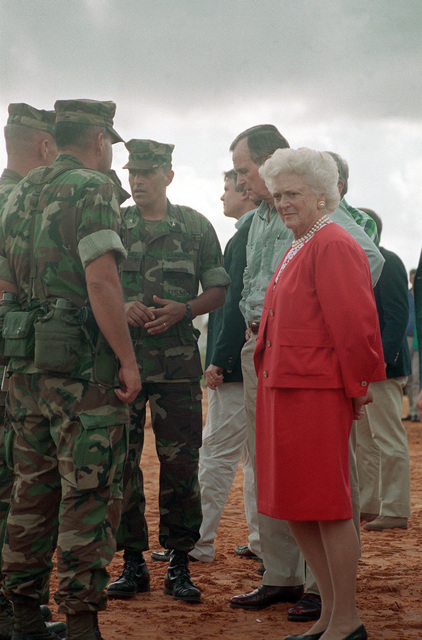 President George Bush and Barbara Bush speak with Marines taking part in the disaster relief efforts in the aftermath of Hurricane Andrew