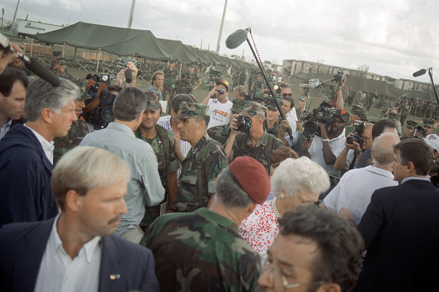 President George Bush and Barbara Bush visit with Marines taking part in the disaster relief efforts in the aftermath of Hurricane Andrew