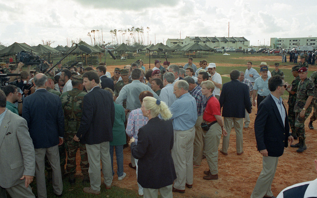 President George Bush, Barbara Bush and Secretary of Defense Richard Cheney speak with a gathering of military personnel and civilians at a campsite set up to provide shelter for area residents in the aftermath of Hurricane Andrew
