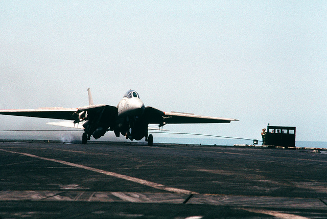 A Fighter Squadron 21 (VF-21) F-14 Tomcat aircraft hooks an arresting cable on the flight deck of the aircraft carrier USS INDEPENDENCE (CV-62). The INDEPENDENCE is participating in OPERATION SOUTHERN WATCH, a multinational effort establishing a no-fly zone for Iraqi aircraft south of the 32nd parallel in Iraq