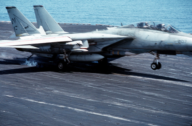 The pilot of a Fighter Squadron 21 (VF-21) F-14 Tomcat aircraft prepares to take off after missing the last arresting cable on the flight deck of the aircraft carrier USS INDEPENDENCE (CV-62). The INDEPENDENCE is participating in OPERATION SOUTHERN WATCH, a multinational effort establishing a no-fly zone for Iraqi aircraft south of the 32nd parallel in Iraq
