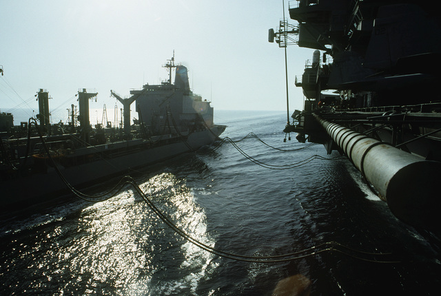 The fleet oiler USNS ANDREW J. HIGGINS (T-AO-190) delivers fuel to the aircraft carrier USS INDEPENDENCE (CV-62) during an underway replenishment. The INDEPENDENCE is participating in OPERATION SOUTHERN WATCH, a multinational effort establishing a no-fly zone for Iraqi aircraft south of the 32nd parallel in Iraq