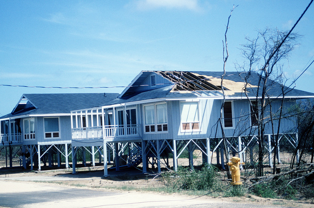 A beach cottage at the Pacific Missile Range Facility, Kauai, displays damage caused by Hurricane Iniki