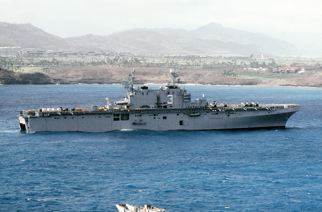 A starboard beam view of the amphibious assault ship USS BELLEAU WOOD (LHA-3) off the coast of the island of Kauai. The vessel is dispensing supplies to the island by landing craft and helicopter as part of Joint Task Force Garden Isle, a joint military disaster relief effort organized to provide assistance to residents of the region in the aftermath of Hurricane Iniki