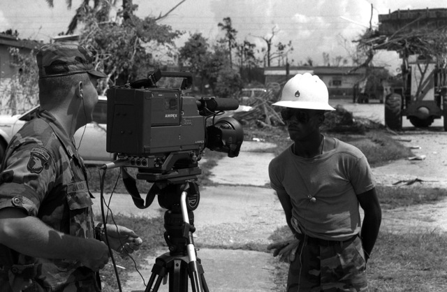Army SGT Bennie Hayden, Combat Pictorial Detachment, Fort Meade, Maryland, interviews SSG Edgar Dixon, from the 46th Engineer Battalion, Fort Rucker, about the damages incurred by the small town near the base as a result of Hurricane Andrew