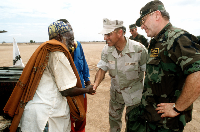 At Oddur (Somalia, Vice Chairman of the Joint Chiefs of STAFF, Admiral David E. Jeremiah (left), talks with local tribesman about the conditions and Operations Provide Relief efforts. Admiral Jeremiah was given a tour through the village where he observed refugee conditions and relief efforts in that area