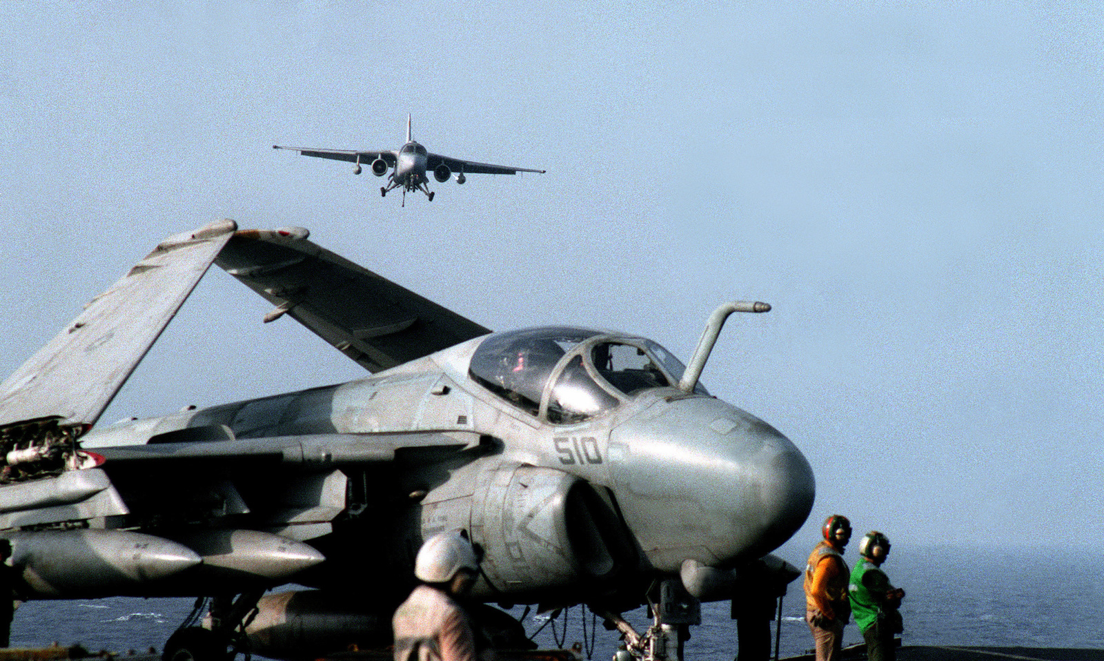 An Air Test and Evaluation Squadron 1 (VX-1) ES-3A Shadow aircraft approaches the flight deck of the aircraft carrier USS SARATOGA (CV-60) during the NATO exercise Display Determination '92. An A-6E Intruder aircraft is in the foreground