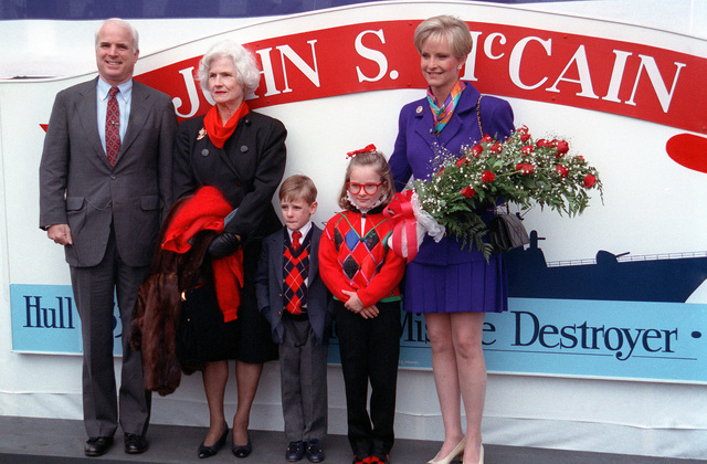 Members of the christening party for the guided missile destroyer JOHN S. MCCAIN (DDG-56) pose for a photograph after the launching at the Bath Iron Works shipyard. They are from left to right: Sen. John McCain; Mrs. John S. McCain Jr.; Sidney McCain; Meghan McCain, maid of honor; and Cindy McCain, sponsor and wife of Sen. McCain