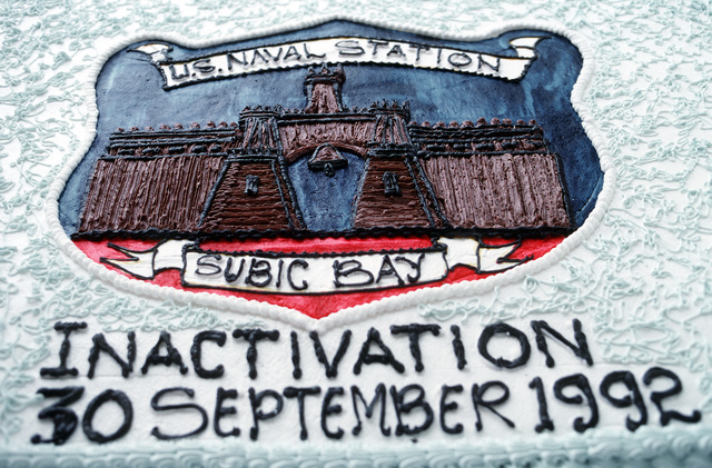 A close-up view of a cake commemorating the deactivation of Naval Station, Subic Bay. Following the deactivation ceremony, control of the station will be assumed by the Subic Bay Metropolitan Authority. The ceremony is taking place at Tappan Park, overlooking the station