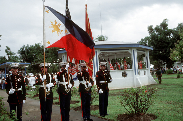 A Marine color guard displays the colors at the conclusion of the deactivation ceremony for Naval Station, Subic Bay. Following the ceremony, which is being held at Tappan Park, the Subic Bay Metropolitan Authority will assume control of the station