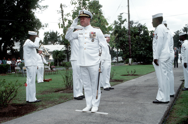 Sideboys salute as RDML Thomas A. Mercer, commander, U.S. Facility, Subic Bay, and U.S. Naval Forces, Philippines, arrives at Tappan Park for the Naval Station, Subic Bay deactivation ceremony. The Subic Bay Metropolitan Authority will assume control of the station following the ceremony
