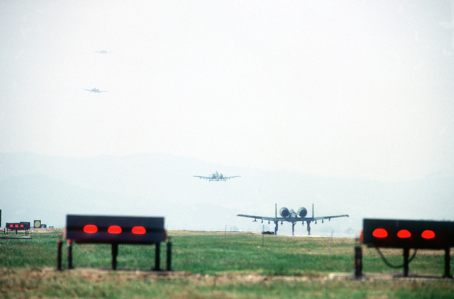 A four-plane group of 19th Tactical Air Support Squadron (19th TASS) OA-10 Thunderbolt II aircraft take off on a mission