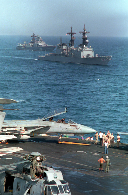 A starboard bow view of the destroyer USS KINKAID (DD-965) and the Russian guided missile destroyer Admiral Vinogradov (BPE-554) as seen from the flight deck of the aircraft carrier USS RANGER (CV-61). The vessels are part of a multinational naval force participating in exercises in the region