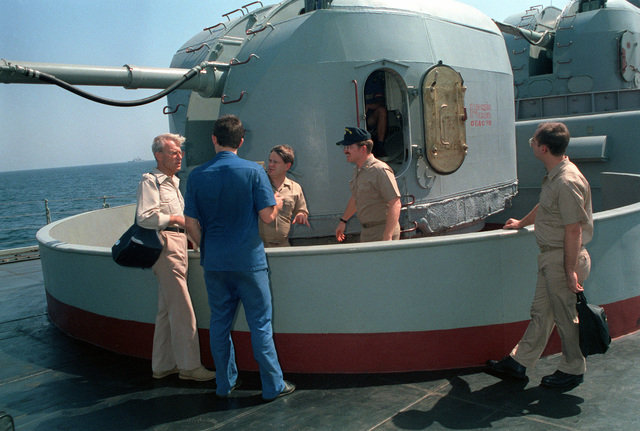 Crew members from the aircraft carrier USS RANGER (CV-61) receive a tour of a 3.9-inch dual purpose gunmount aboard the Russian guided missile destroyer Admiral Vinogradov (BPE-554). Both vessels are part of a multinational naval force participating in exercises in the region