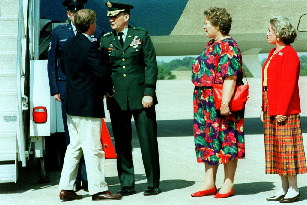 Vice-President Dan Quayle (left) is greeted at the Robert Gray Army Airfield by Lieutenant General Horace G. Taylor, Commanding General III Corps and Fort Hood and Mrs. Taylor during the Vice-Presidential stop over in Fort Hood, Killeen and Harker Heights Texas area