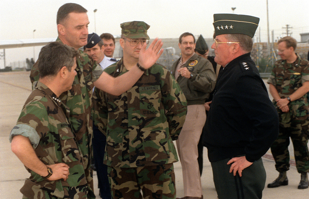 A Marine officer gestures to GEN. John M. Shalikashvili, Supreme Allied Commander/Europe, as Adm. Jeremy M. Boorda, commander-in-chief, U.S. Naval Forces, Europe/Allied Forces, Southern Europe, at Boomer's right, stands by. The dignitaries are on base to observe a special warfare demonstration