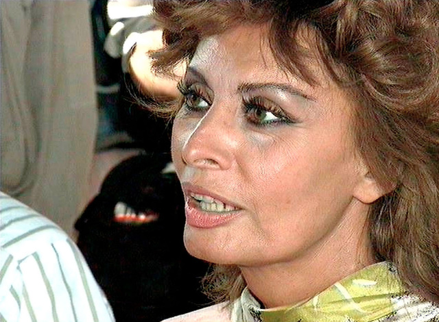 Left side front, extreme close-up of International Film Star Sophia Loren's face as she listens to a briefing by US Marine BGEN Paul Fratarangelo, Commanding General of Joint Task Force Provide Relief, on the operation that has been airlifting food into Somalia. Provide Relief is in direct support of Operation Restore Hope
