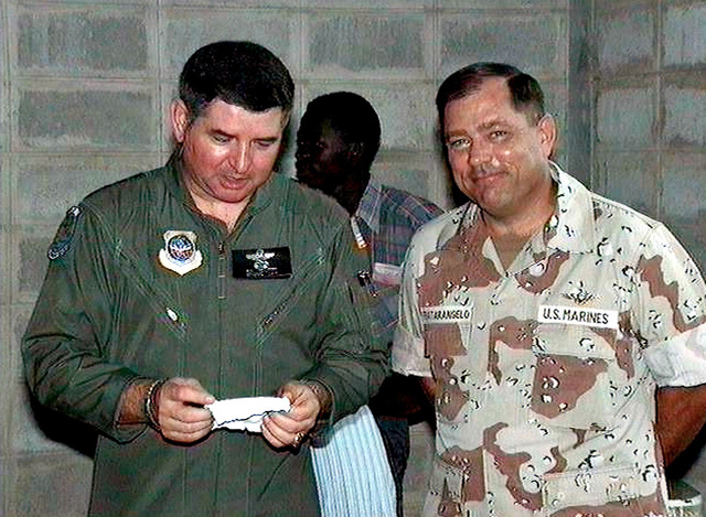US Air Force GEN Ronald Fogelman, Commander in CHIEF, United States Transportation Command and Air Mobility Command, left, discusses how Operation Provide Relief efforts into Somalia are progressing with US Marine BGEN Paul Fratarangelo, right, Commanding General of Joint Task Force Provide Relief. Provide Relief is in direct support of Operation Restore Hope