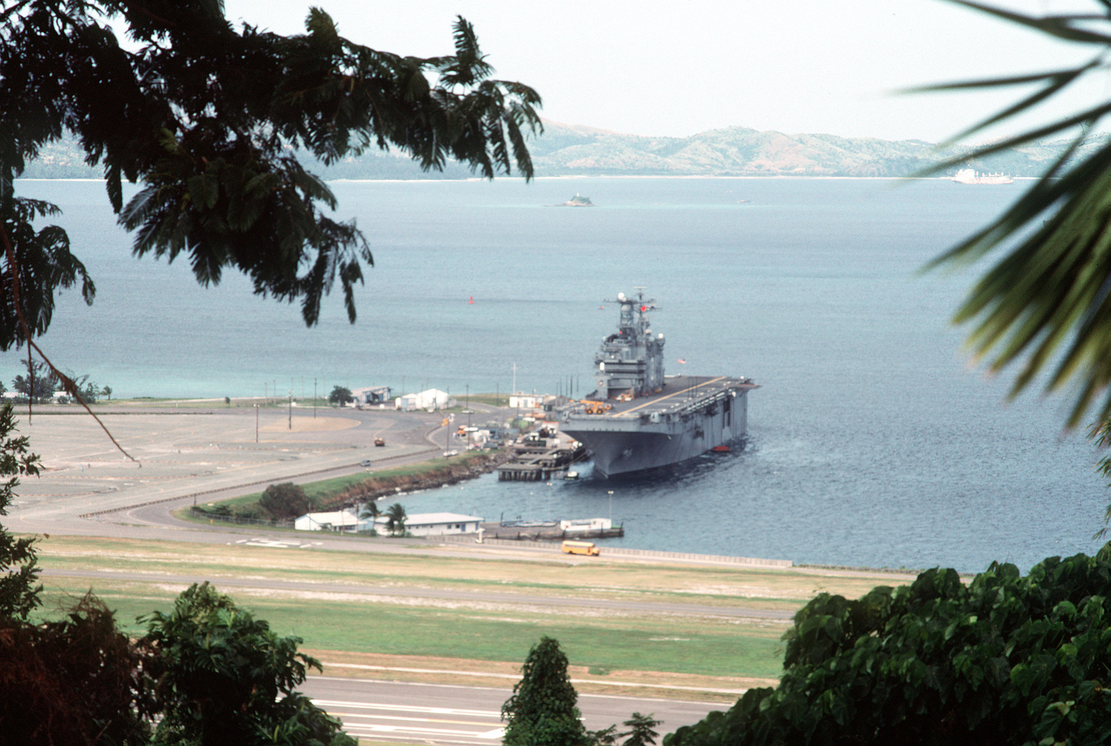 The amphibious assault ship USS BELLEAU WOOD (LHA-3) is docked at Leyte Pier prior to departing from the station. U.S. naval forces are departing from Naval Station, Subic Bay and Naval Air Station, Cubi Point, control of which will be assumed by the Philippine government