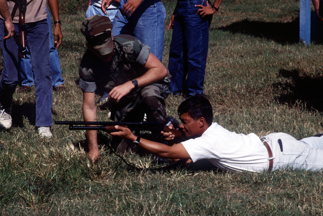 A U.S. Marine instructs a recruit from the Subic Bay Metropolitan Authority (SBMA) on the use of a 12 gauge shotgun. SBMA will be assuming control of NAS, Cubi Point