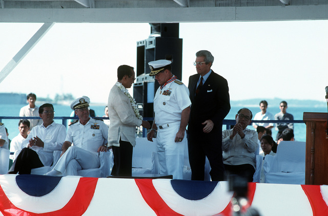 RADM Thomas A. Mercer, commander, Naval Station, Subic Bay/U.S. commander-in-chief, Pacific, Republic of Philippines, receives the Philippine Medal of Honor from Philippine President Fidel V. Ramos during the deactivation ceremony for Naval Station, Subic Bay. Both Subic Bay and Naval Air Station, Cubi Point, are being relinquished to the Philippine government and Subic Bay will be recognized as Subic Bay Metropolitan Authority Headquarters