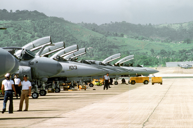 NC-10B powerplants are positioned at the end of a line of A-6E Intruder and F-14A Tomcat aircraft during servicing of the aircraft prior to a mission