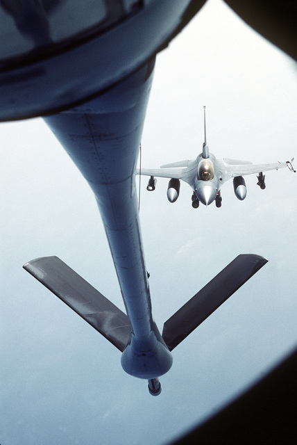An F-16 Fighting Falcon aircraft from the 36th Fighter Squadron approaches the refueling boom of a 310th Air Refueling Squadron KC-135 stratotanker aircraft during a Pacific Tanker Task Force refueling mission