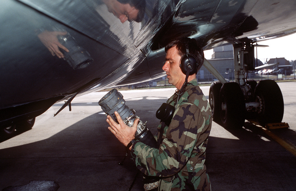 TECH. SGT. Henry Weaver, a crew chief from the 310th Air Refueling squadron, prepares his KC-135 Stratotanker aircraft for an upcoming Pacific Tanker Task Force refueling mission on the flight line