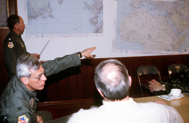 Ambassador Richard Capen, US Ambassador to Spain, is briefed on tanker operations by COL. Joseph Simeone and his staff