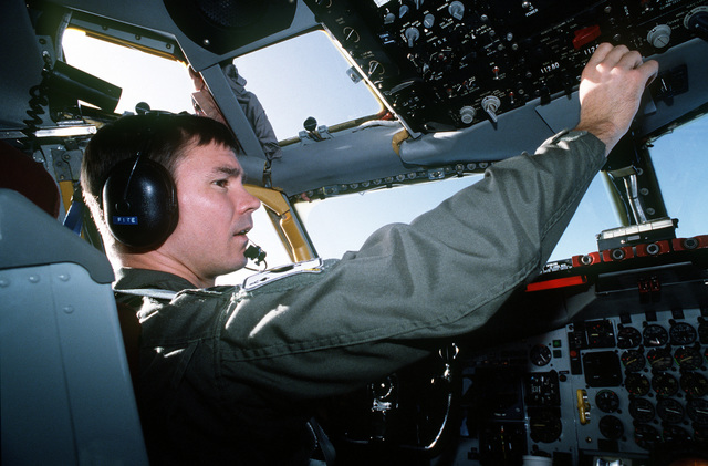 """CAPT. Mike Boyington, a KC-135 pilot from the 434th Air Refueling Wing, AFRES, Grissom AFB, Indiana, performs flight operations in preparation for the refueling of a C-5 """"Galaxy"""" supporting the operation"""