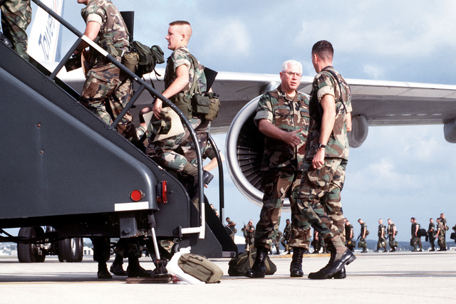 MAJ. GEN. Donald R. Gardner, commanding general, III Marine Expeditionary Force/Marine Corps Bases, Japan, shakes hands and talks with members of the 12th Marine Regiment as they board a chartered flight to I Marine Expeditionary Force headquarters at Camp Pendleton, Calif. From Camp Pendleton, the Marines will be transported to Somalia to participate in Operation Restore Hope
