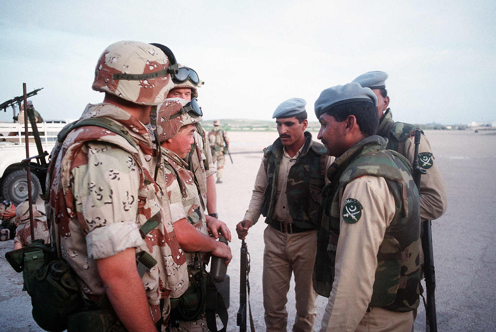 U.S. Marines converse with Pakistani military personnel at Mogadishu International Airport. The troops are in the