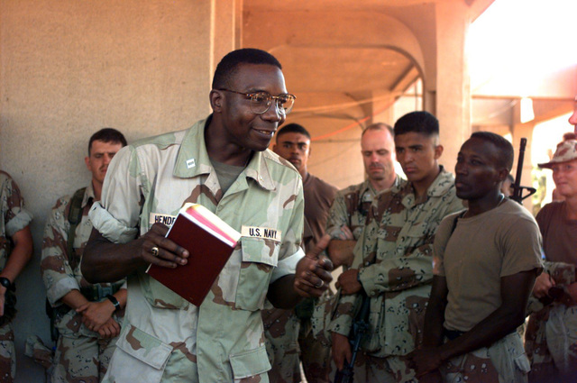 Navy Chaplain (LT. CMDR.) Melvin Hendricks, 9th Communications Battalion, Camp Pendleton, CA, gives a sermon during Christmas Day Protestant services for military personnel. Chaplain Hendricks was the guest speaker for the services which were held in the former American Embassy compound. The compound has become Headquarters for Joint Task Force (JTF) Somalia