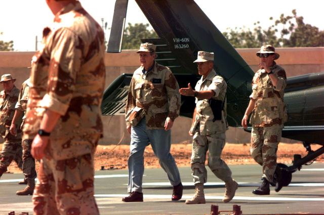 President George Bush is greeted by US Marine Corps GEN. Robert B. Johnston, commander, Joint Task Force his arrival at the American Embassy Compound