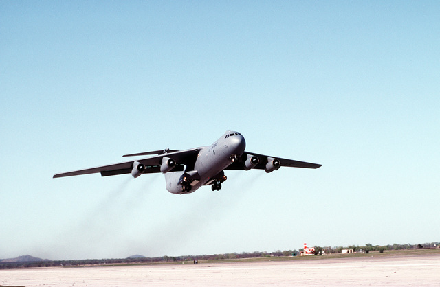 A C-141B Starlifter aircraft assigned to the 443rd Airlift Wing (443rd AW) takes off from a base
